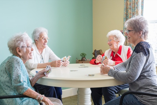Independent seniors playing cards